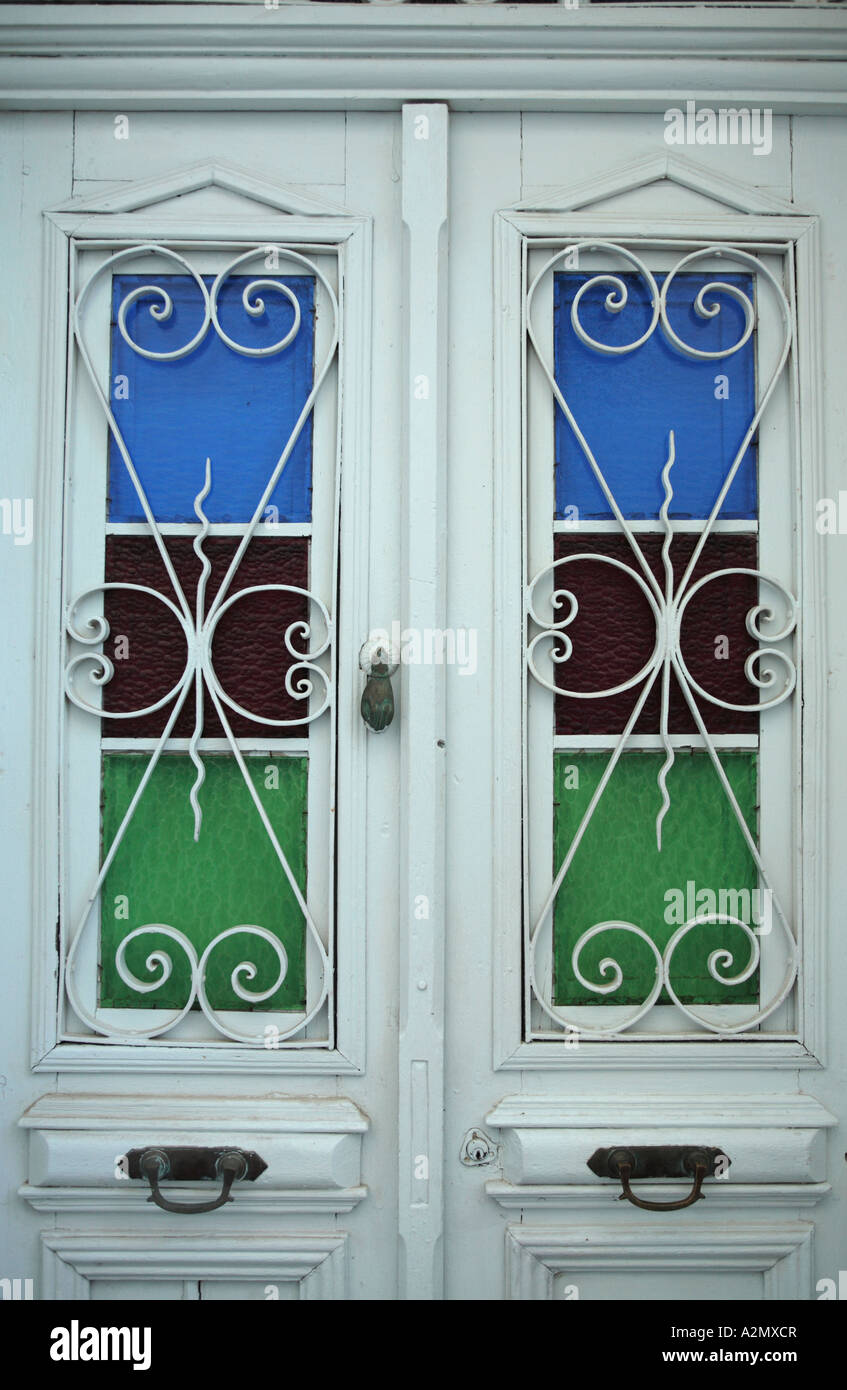 two typically ornate southern european timber doors Stock Photo