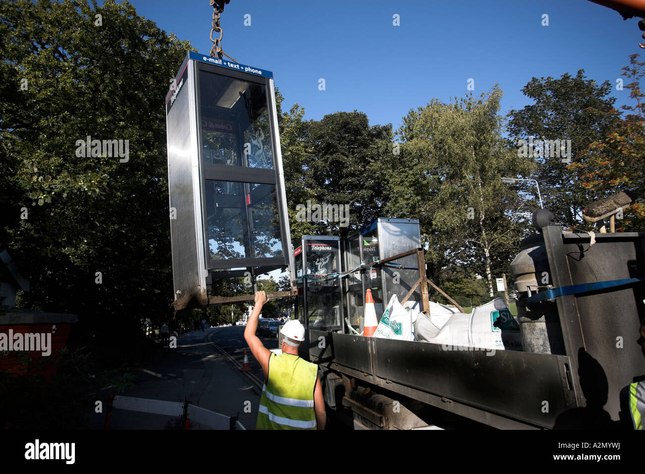 Removing Pay Phone Redundant due to Mobile /cell phone use Bownees on Windermere Cumbria UK - Stock Image