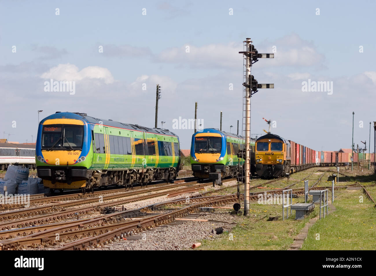 Two Central Trains Class 170 DMUs passing each other near March in Cambridgeshire - Stock Image