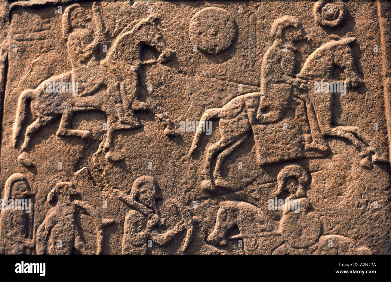 Celtic Pictish symbol stone slab detail in Aberlemno churchyard, Tayside, Scotland. Battle scene with horse cavalry and spearmen Stock Photo
