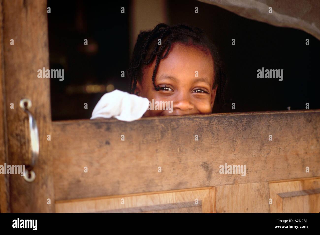 Latch key kid girl window broken screen door of apartment ...