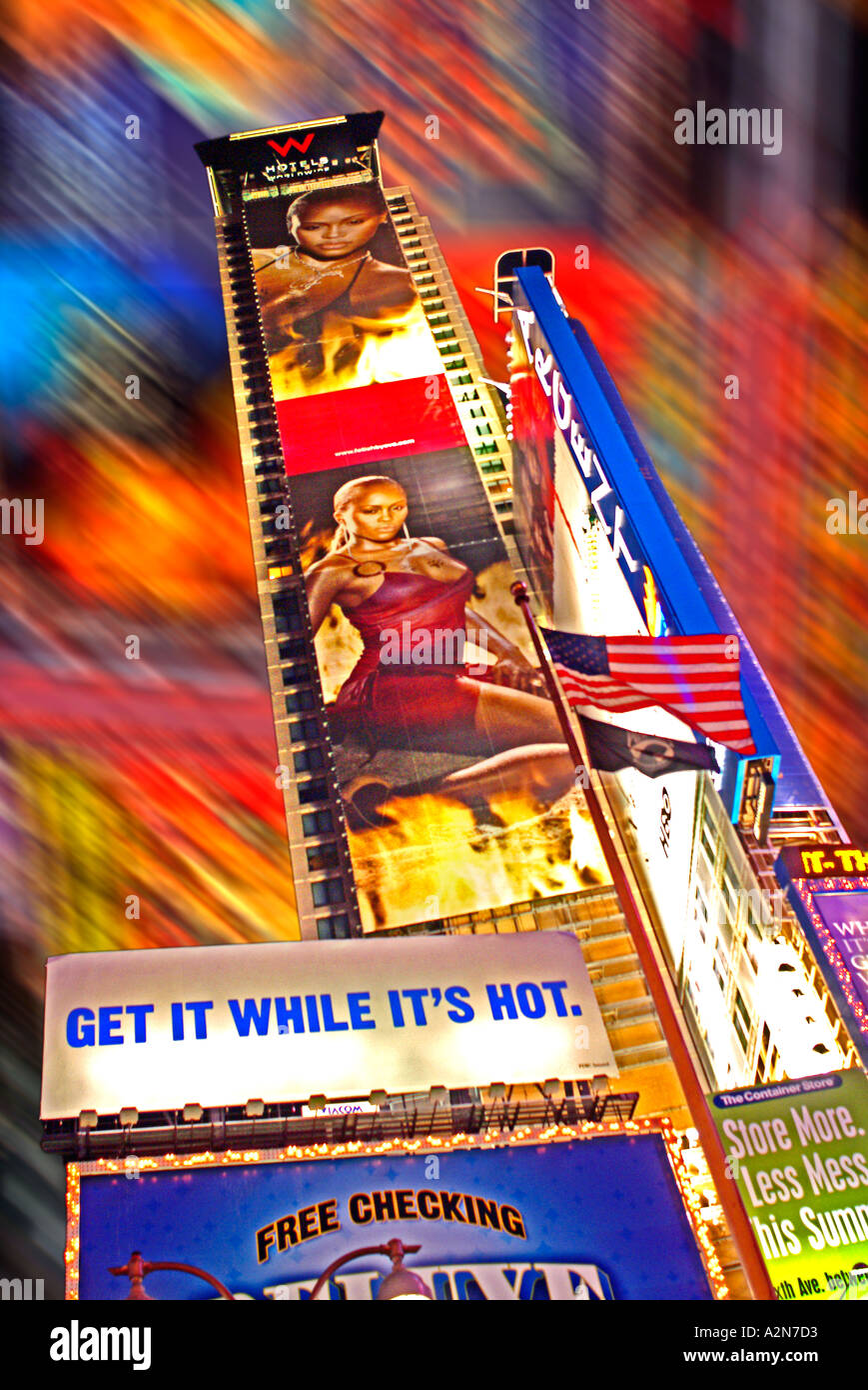 Advertising signs on storefronts in New York City times Square and Broadway - Stock Image
