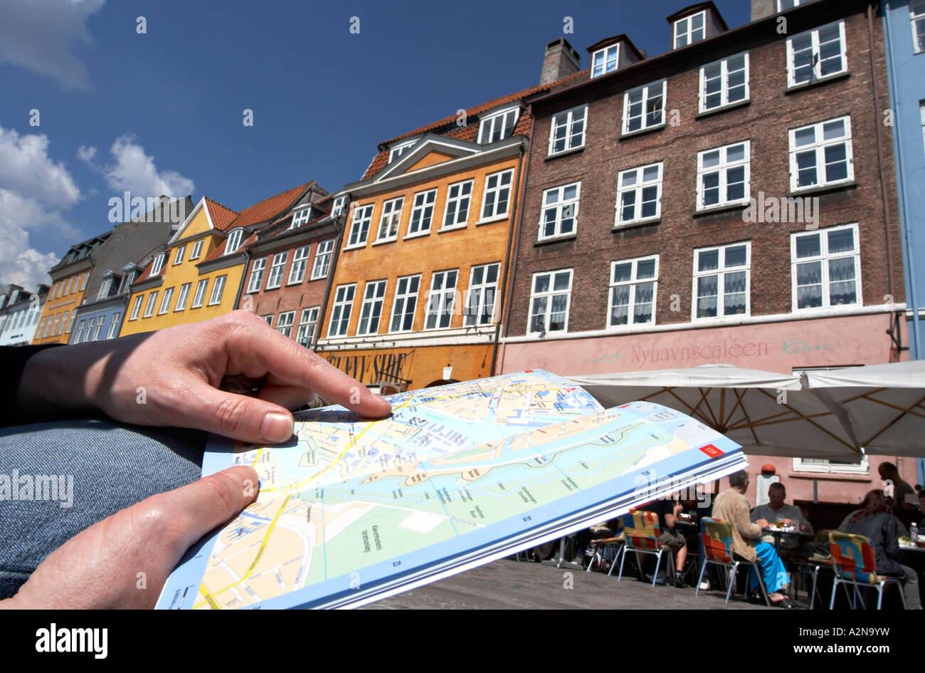 Tourist holding map, Nyhavn, Copenhagen, Denmark - Stock Image