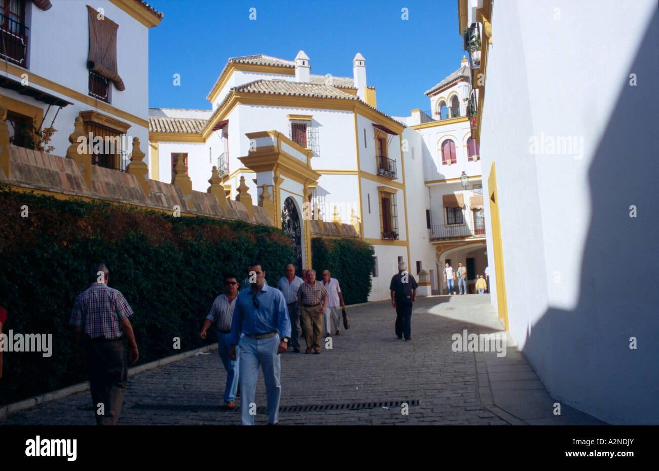 People coming out from bullring, Real Maestranza de Caballeria de Sevilla, Seville, Andalusia, Spain - Stock Image