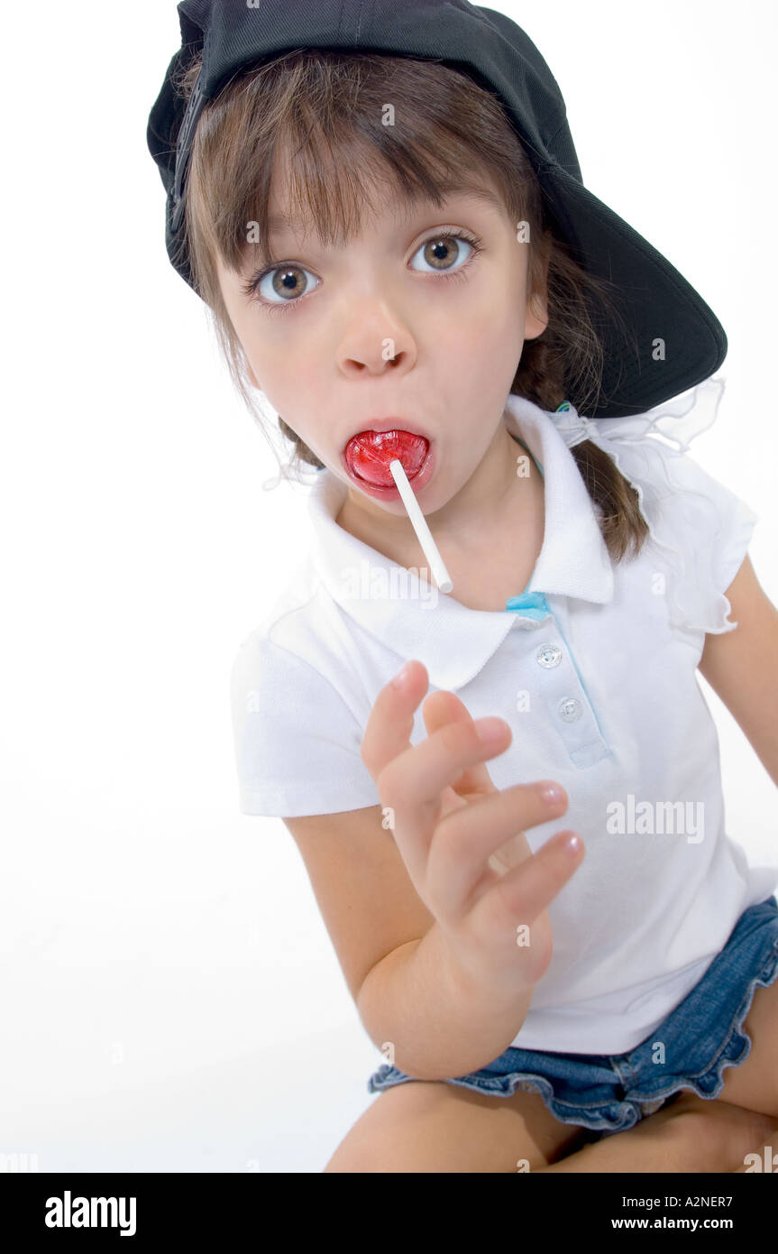 Little Girl with Baseball Hat and Lollipop Stock Photo  6036470 - Alamy 08634529918