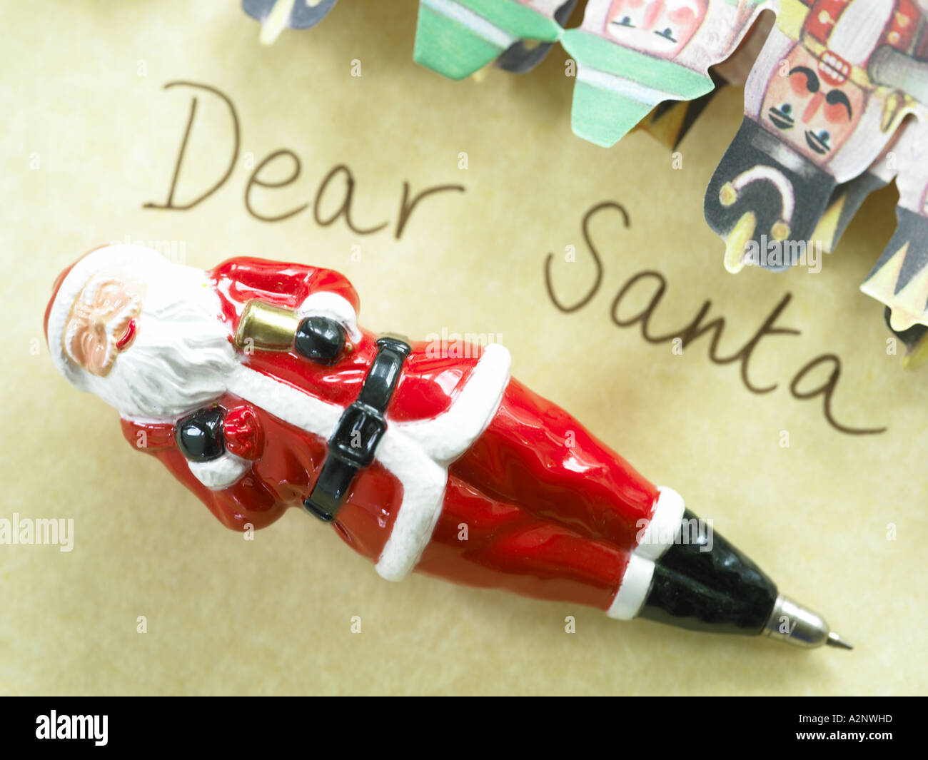 dear santa note written on paper with father xmas pen with paper christmas decorations - Stock Image