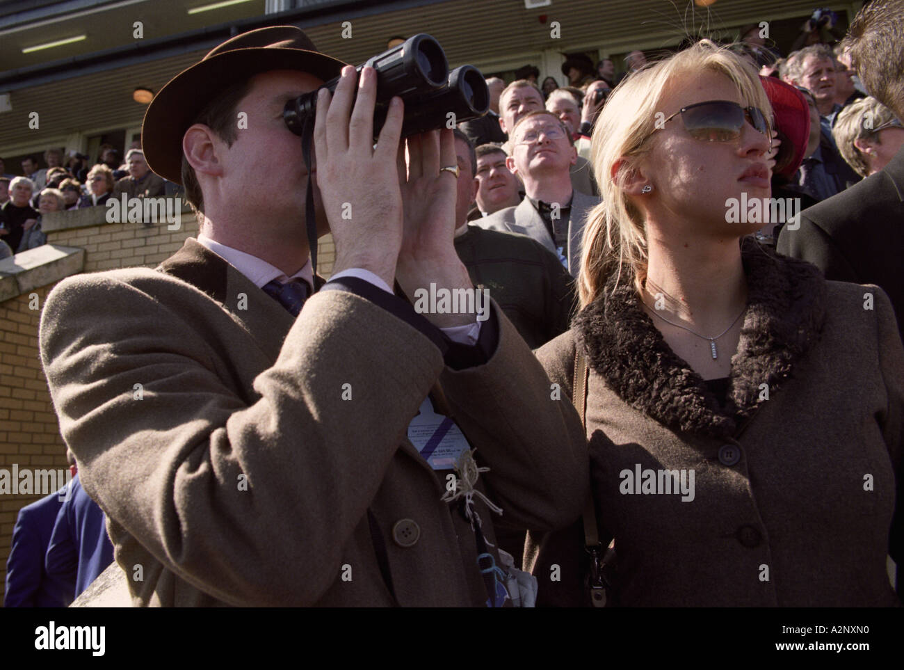 United Kingdom, England, Liverpool, Aintree Racecourse Horse racing spectators at the Grand National Stock Photo