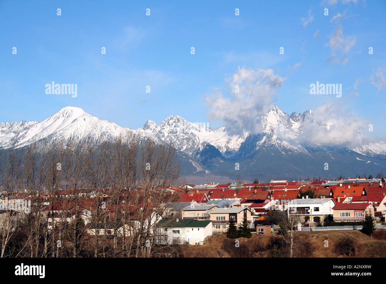 High Tatras Mountains and City of Poprad in Slovakia in Winter - Stock Image
