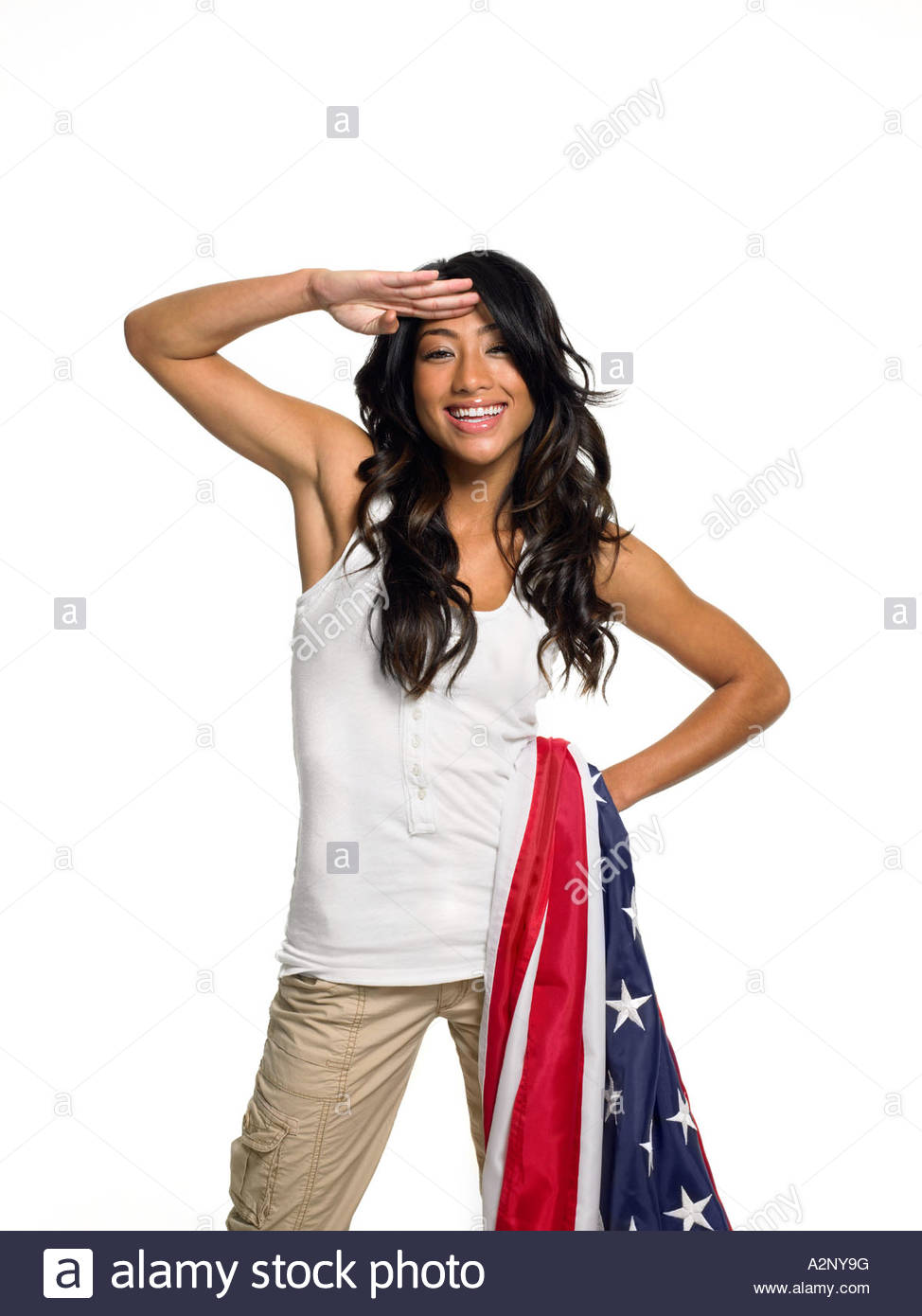 Woman holding a flag and saluting - Stock Image