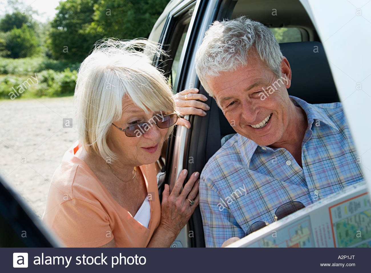 Couple looking at map - Stock Image