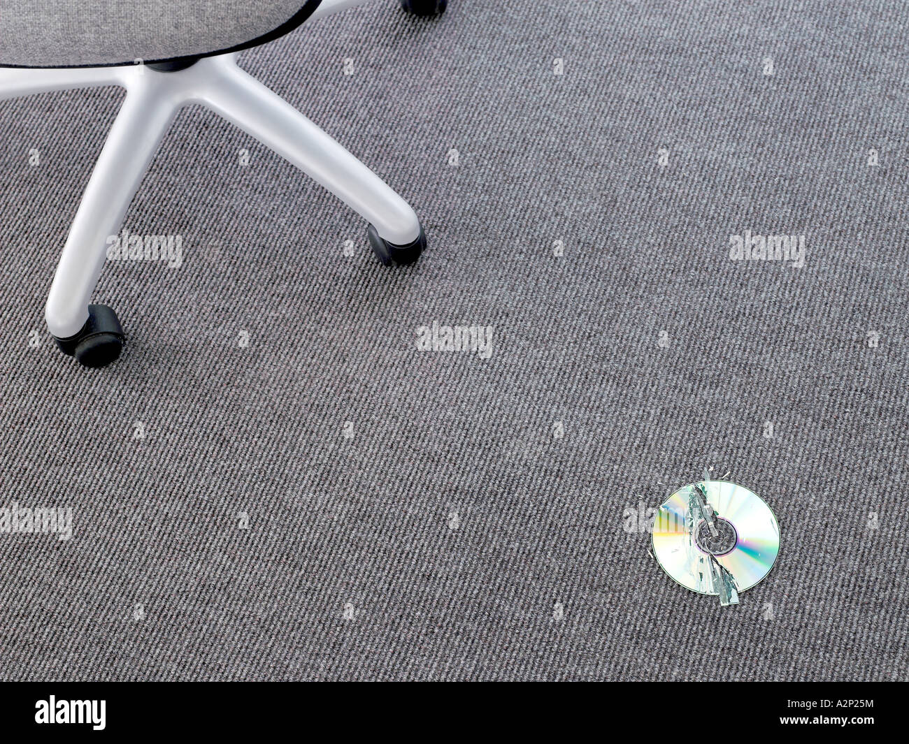Compact disc broken on the floor - Stock Image