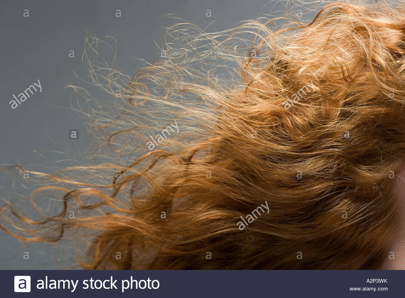 Wavy red hair - Stock Image