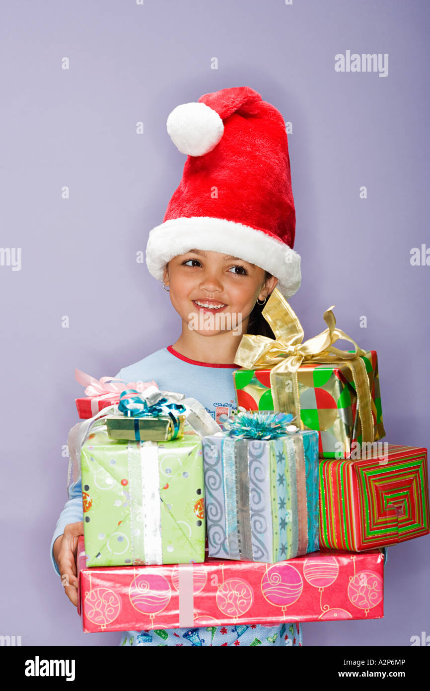 Girl holding presents - Stock Image