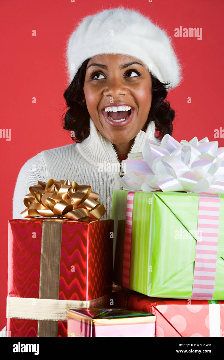 Woman holding presents - Stock Image