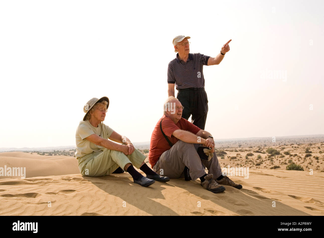 India Rajasthan Thar Desert older western family on sand dunes - Stock Image