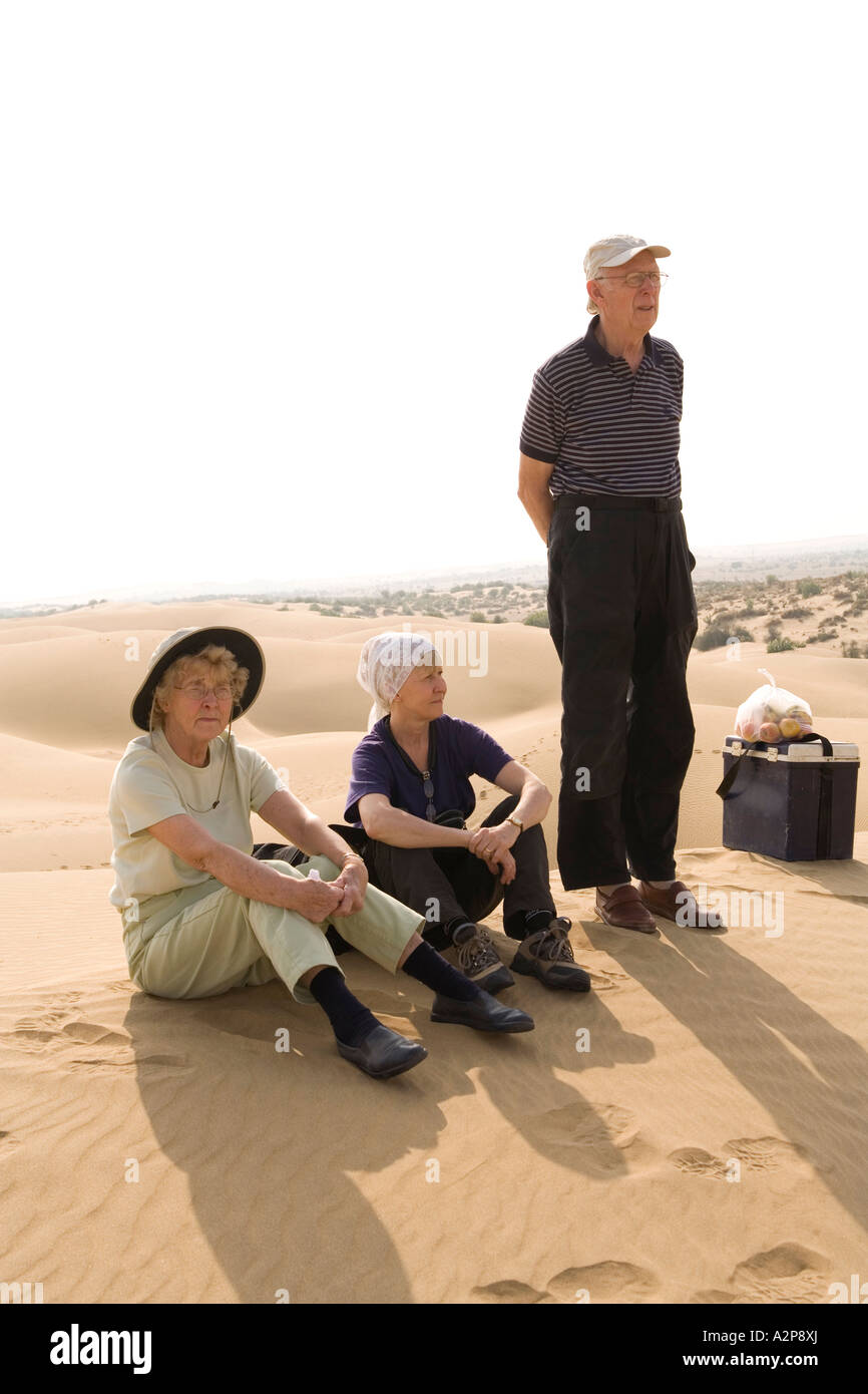 India Rajasthan Thar Desert older western family on holiday excursion to sand dunes - Stock Image