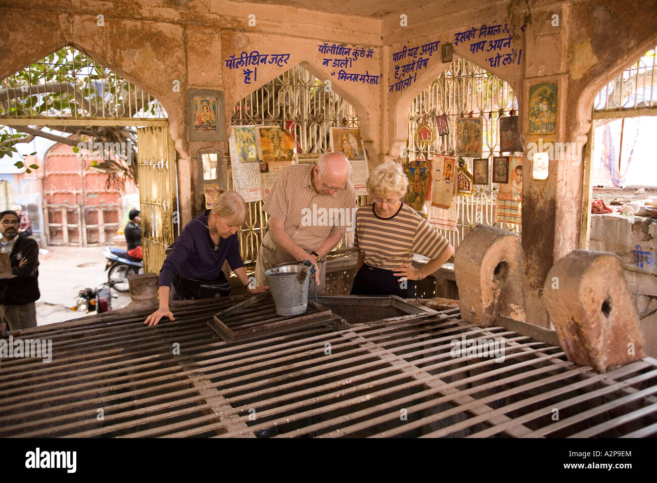India Rajasthan Jodhpur old city older western visitors in covered well Stock Photo