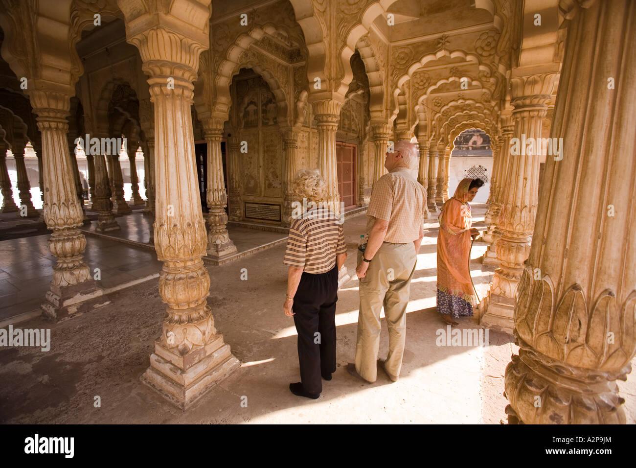 India Rajasthan Jodhpur older western tourists in Maha Mandir the great temple Stock Photo