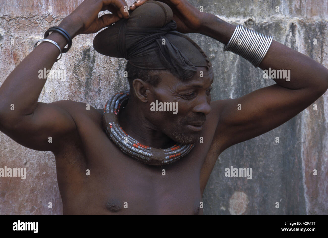 Himba, chief with typical headdress and trappings on the neck, Namibia, Kunene, Kaokoland - Stock Image