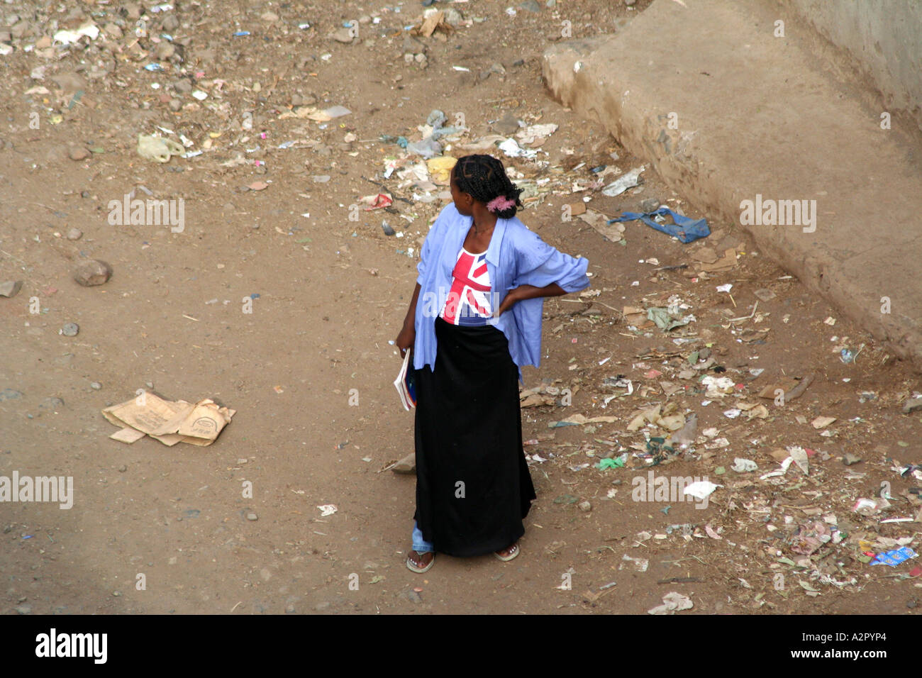 5916a536e6d5d Young woman with a british flag t-shirt looks back, Gonder, Ethiopia ...