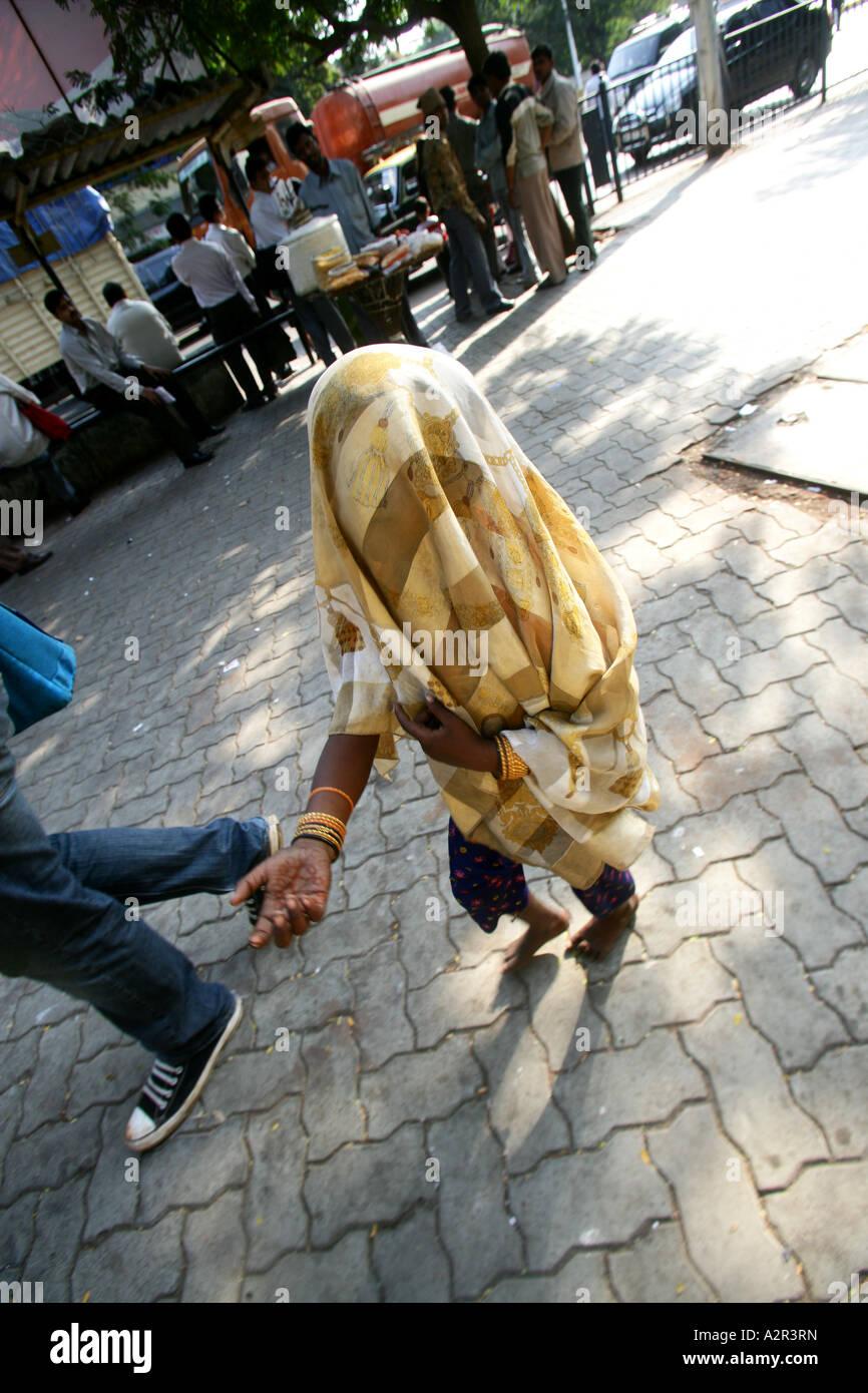 Beggars on the streets of Mumbai India - Stock Image