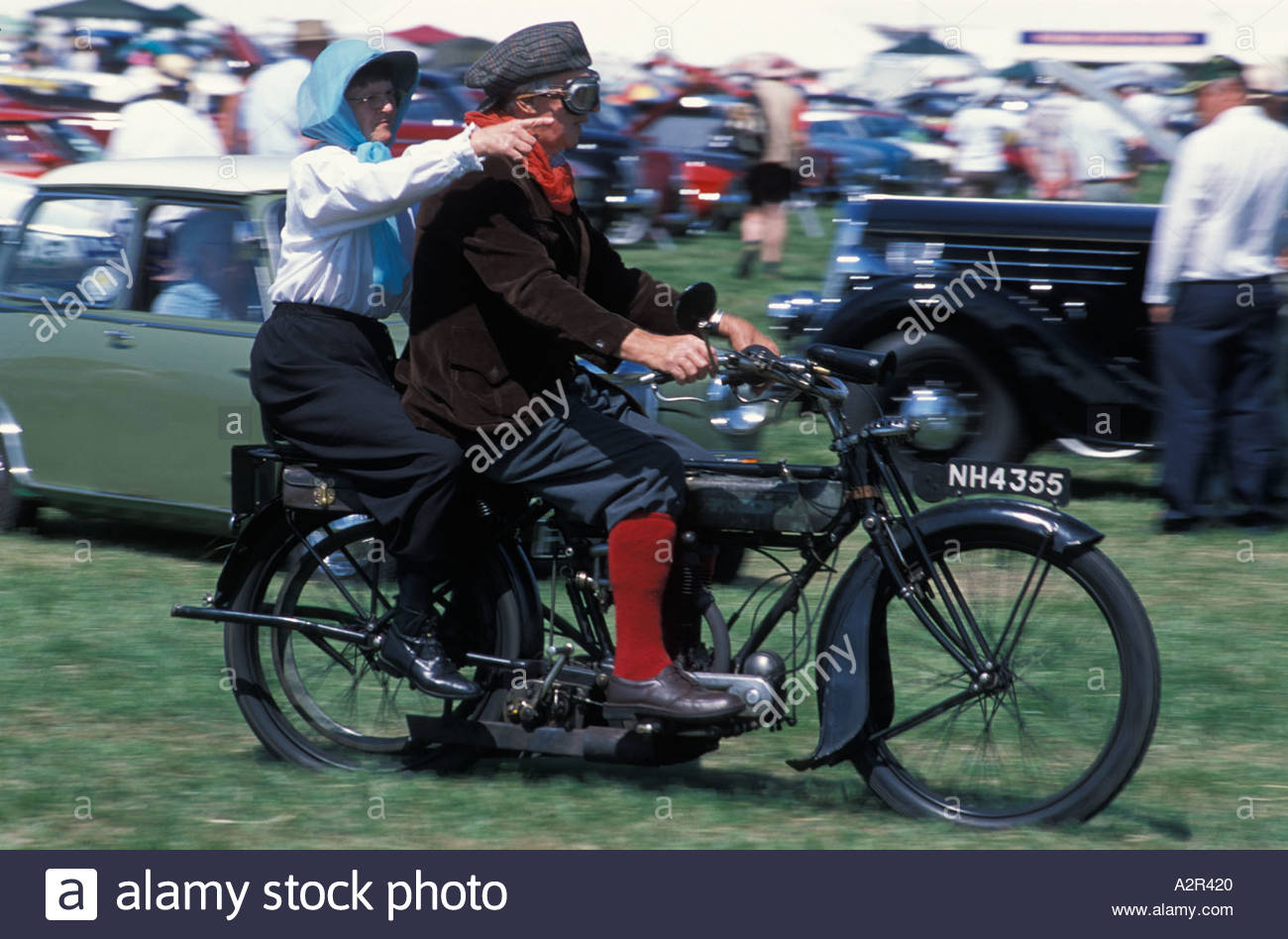 Couple on a vintage motorcycle at the Gloucester Steam Fair, UK - Stock Image