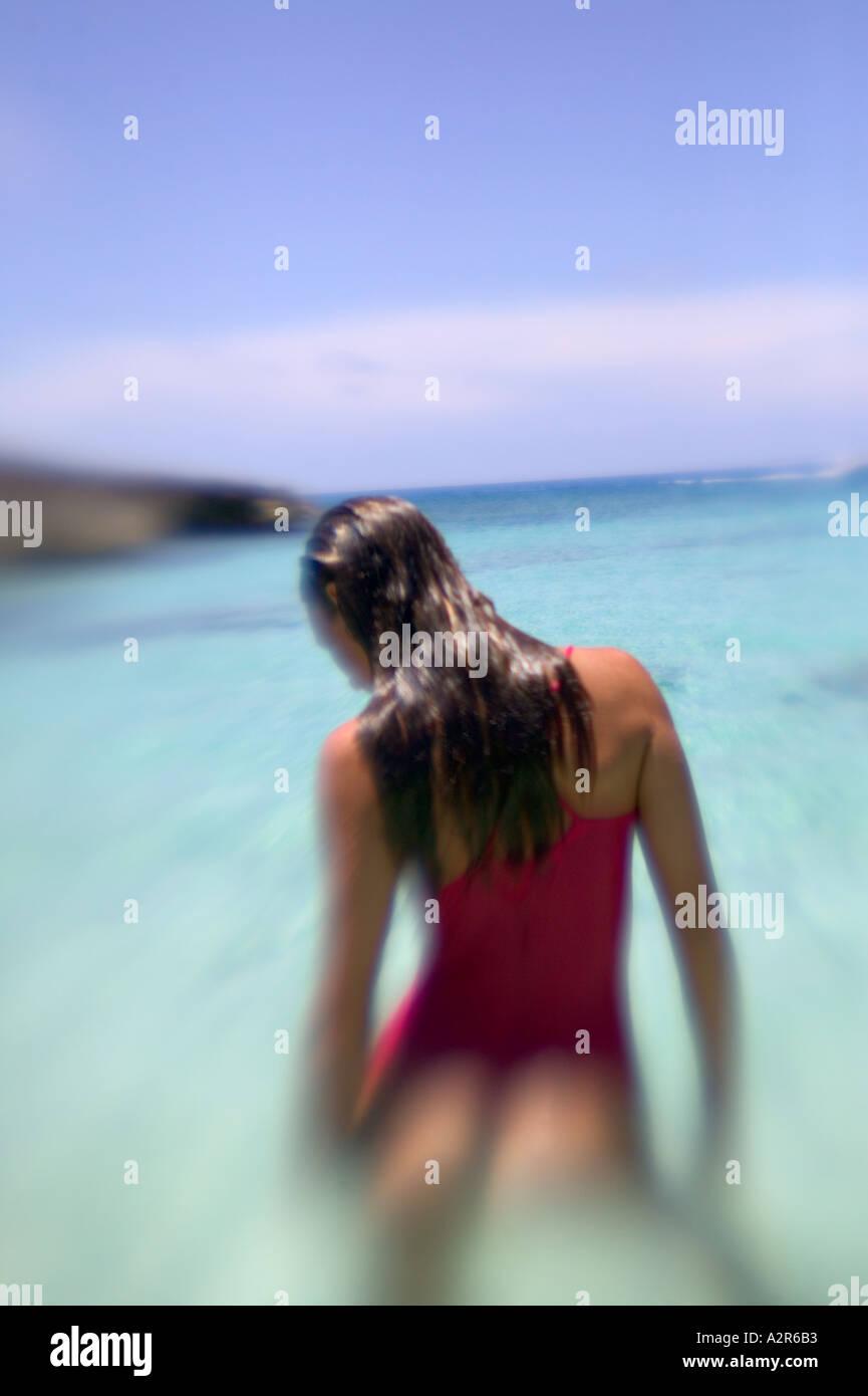 Woman in water on uninhabited island Elbow Cay Cay Sal Bank Bahamas Islands Stock Photo