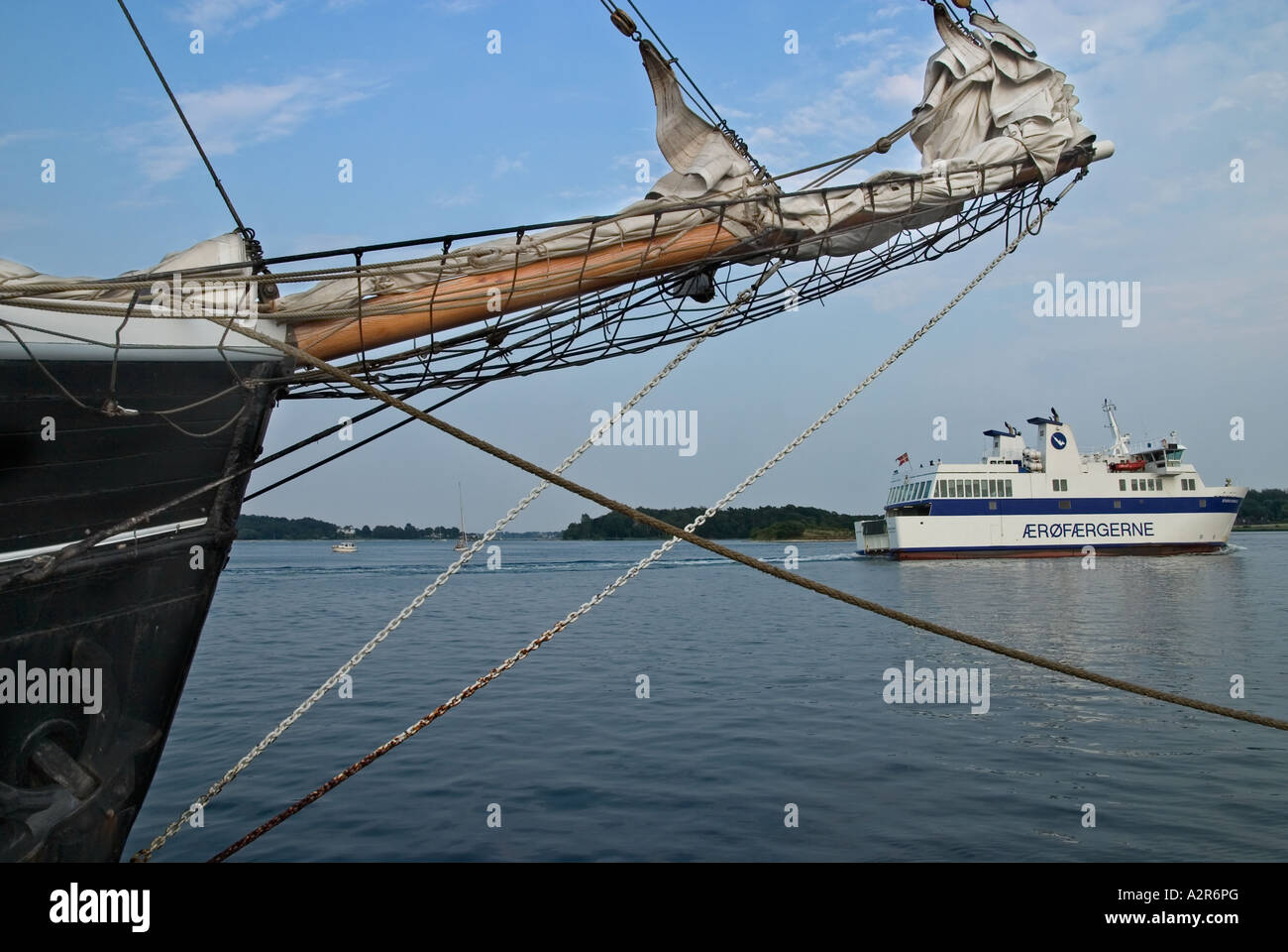 Old Sailing Ships in harbour Svendborg while a small island ferry leave Svendborg fyn Funen Denmark - Stock Image