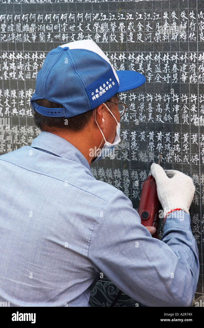 Taiwan, Engraver Putting Names Onto Marble Tablet - Stock Image