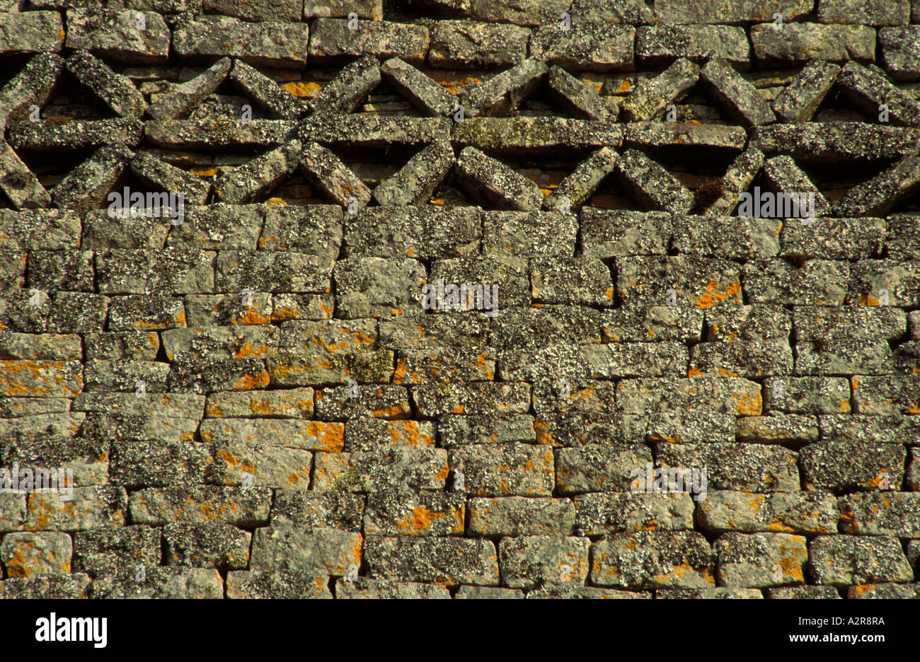 Detail showing herringbone or chevron pattern at top of outer wall of the Great Enclosure at Great Zimbabwe National Monument. - Stock Image