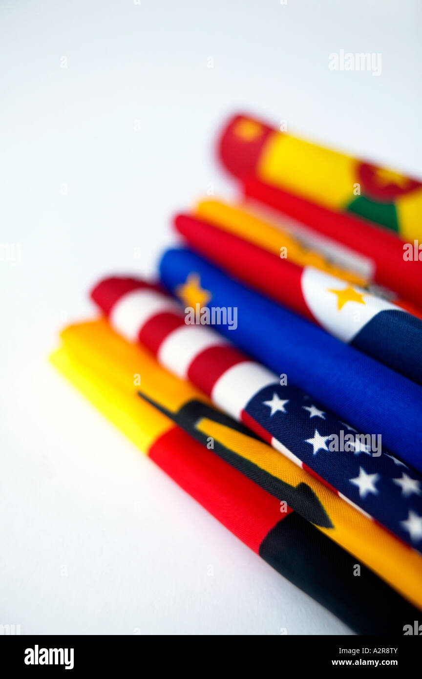 Pile of folded world national flags stars and stripes European Union EEC flag - Stock Image