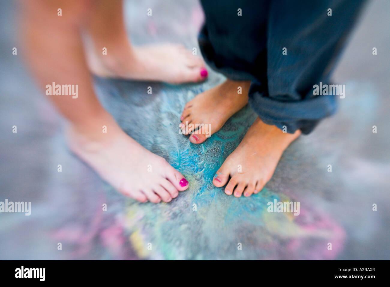 Girls holding their feet 15