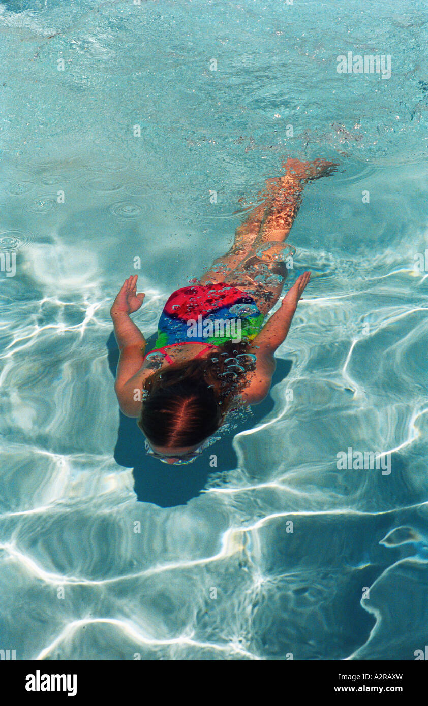Ten year old girl having fun swimming and doing tricks Pool at a hotel in Big Bear California United States of America Stock Photo