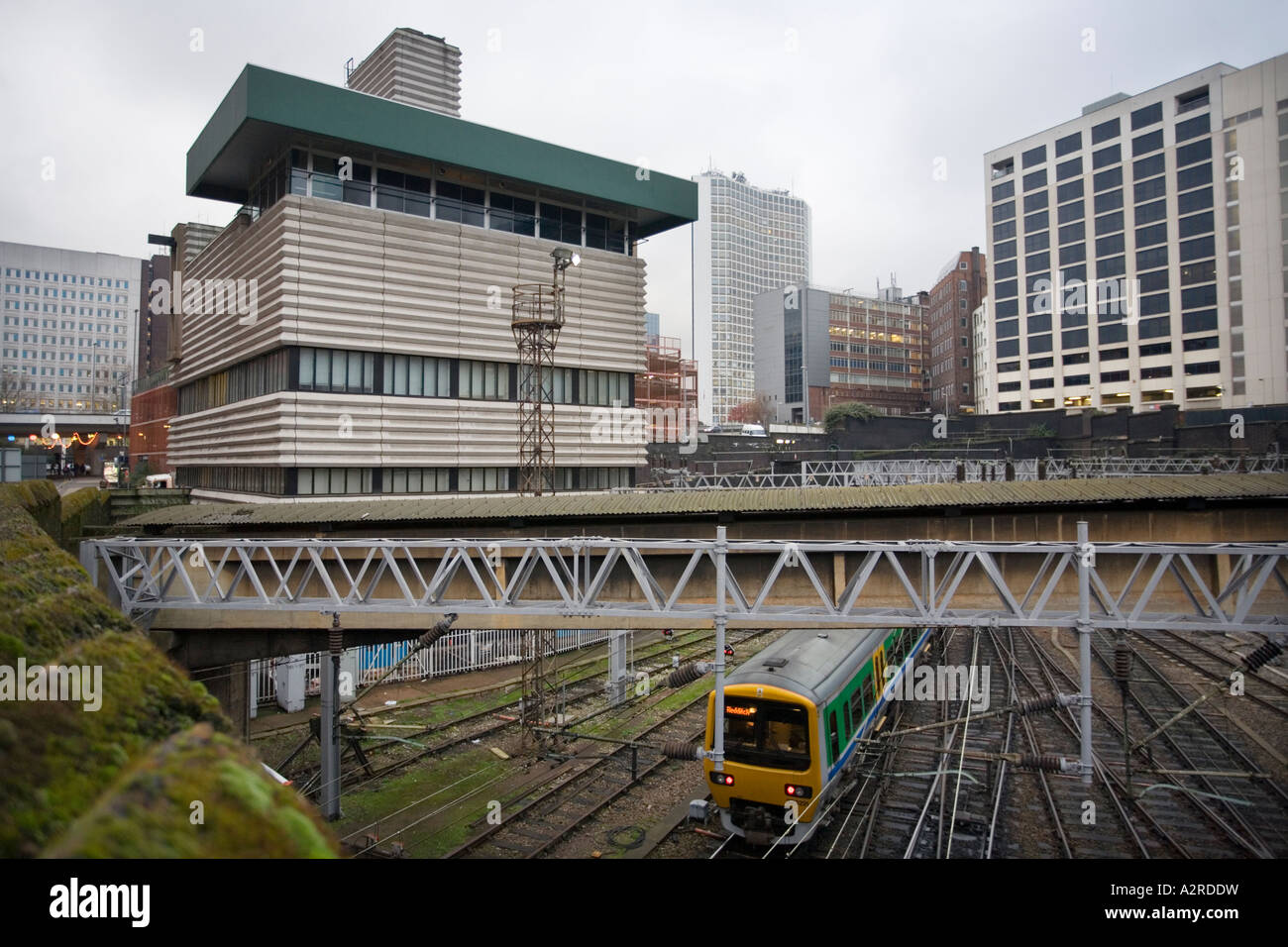 The Grade 2 listed corrugated concrete signal box overlooking rails leading into New Street station in Birmingham - Stock Image