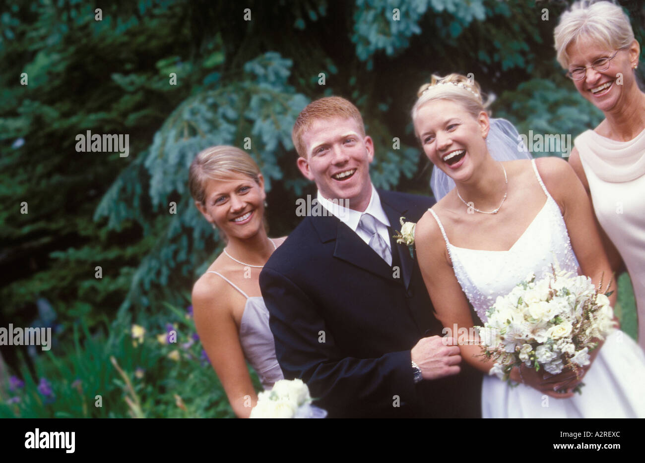 3802cd1ed Portrait of a bride and groom with the brides mother and sister who is the  maid