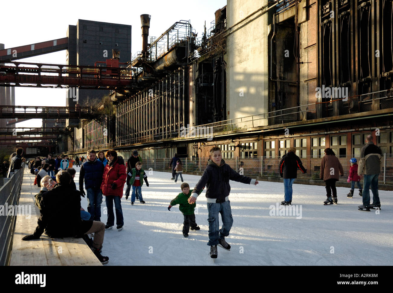 Ice skating at the UNESCO world heritage site Zollverein, Essen, Germany. - Stock Image