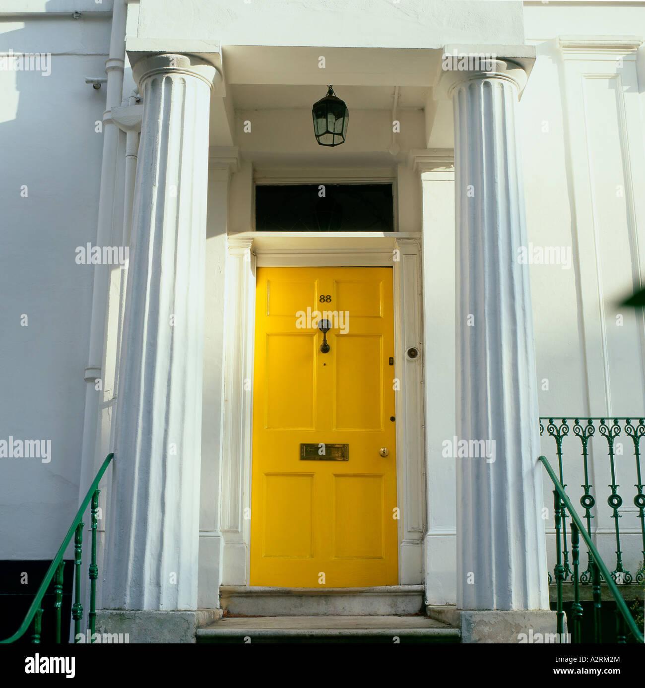 Yellow front door of Georgian House Maida Vale, London England UK ...