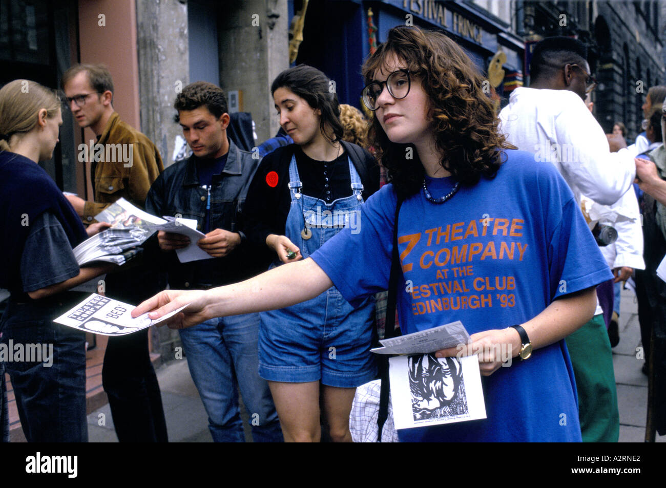 theatre company staff handing out flyers on the street edinburgh