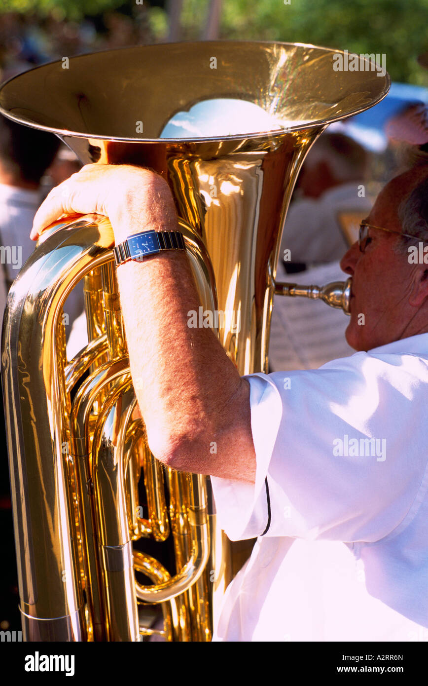 A Senior Man playing a Tuba in a Band Stock Photo