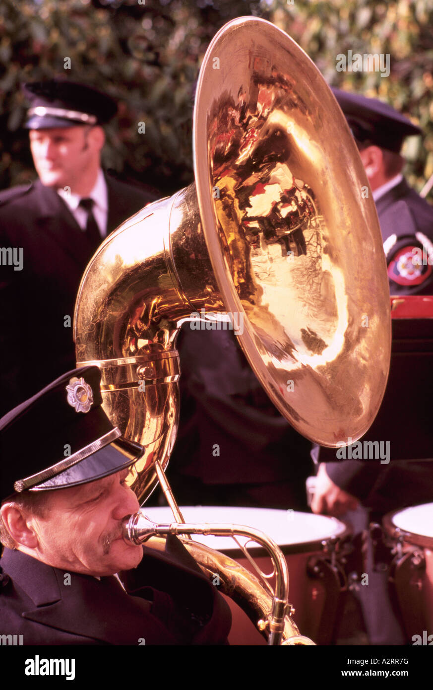 A Senior Man playing a Sousaphone or Tuba in a Band Stock Photo
