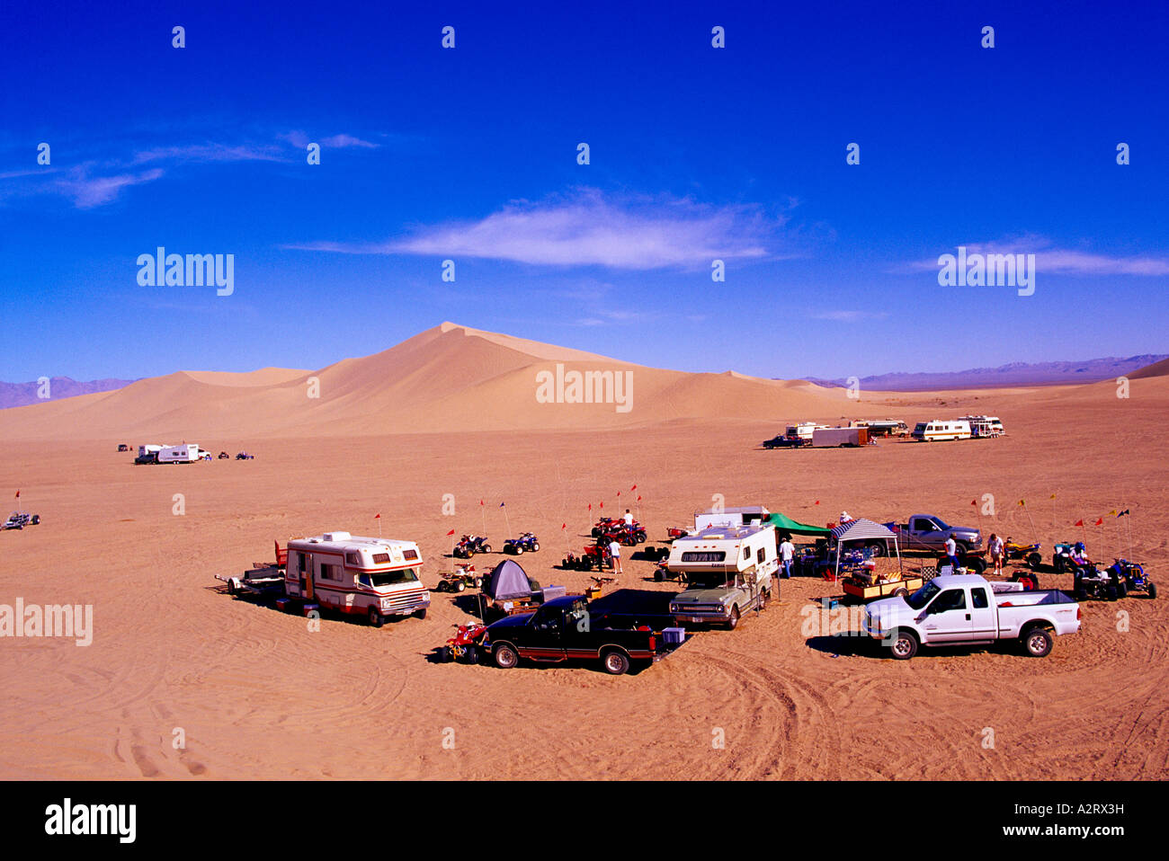 Dune Buggies and Campers at the Dumont Sand Dunes near Death Valley National Park California USA - Stock Image