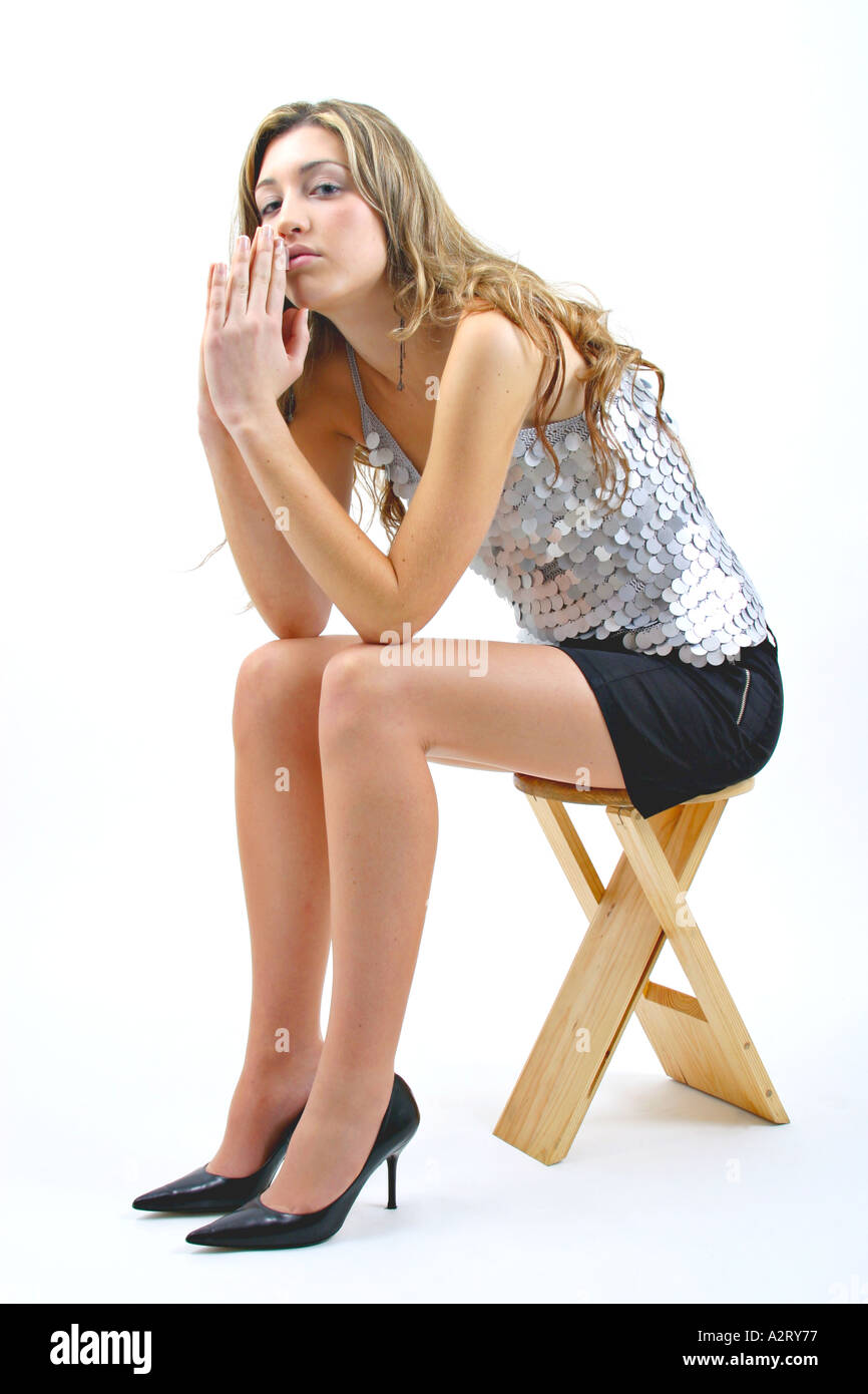 Sitting In Mini Skirt