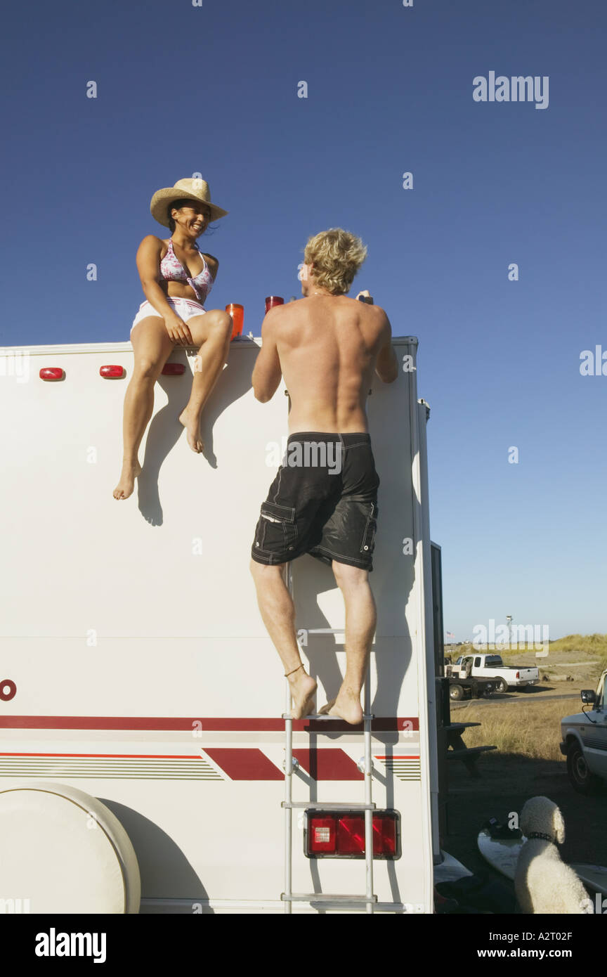 Young couple with a recreational vehicle - Stock Image