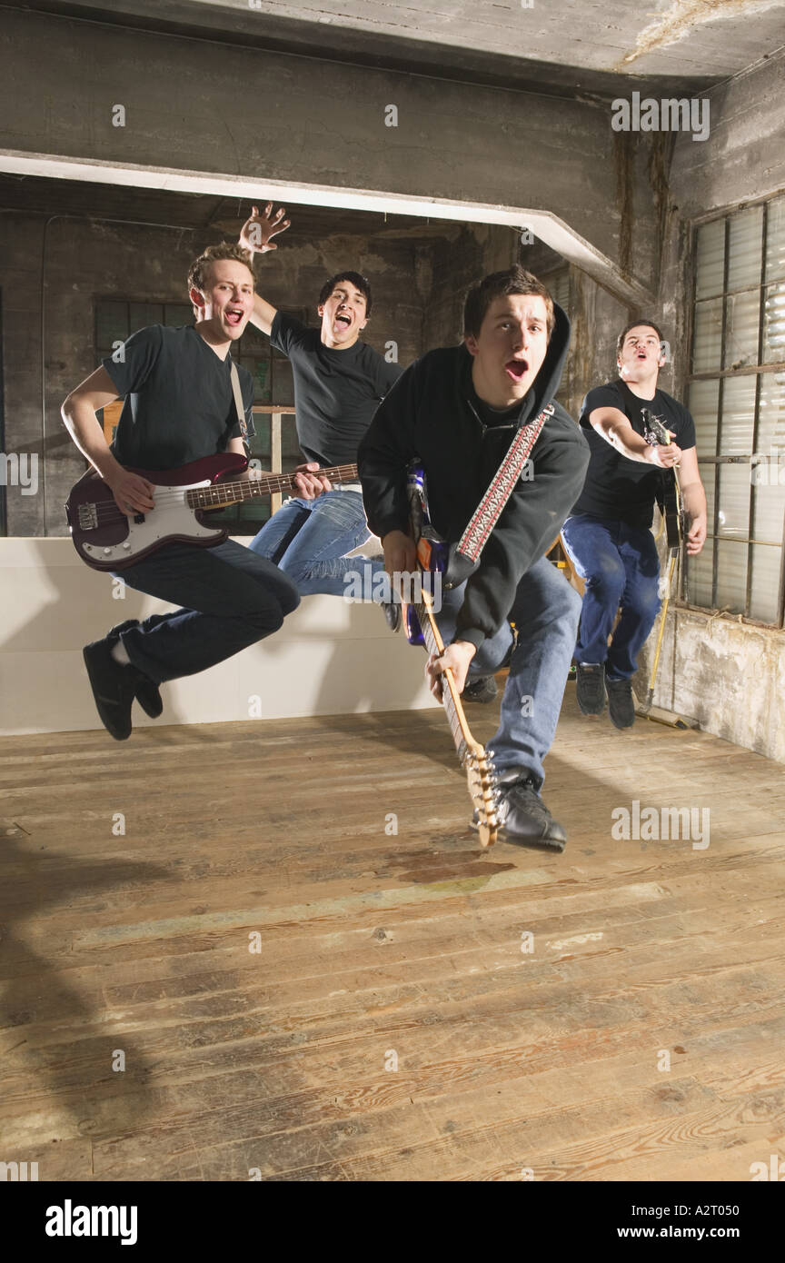 Four men in a band rock out - Stock Image