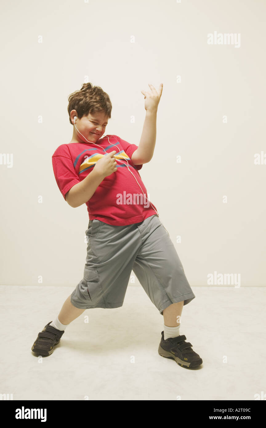 A boy playing the air guitar Stock Photo