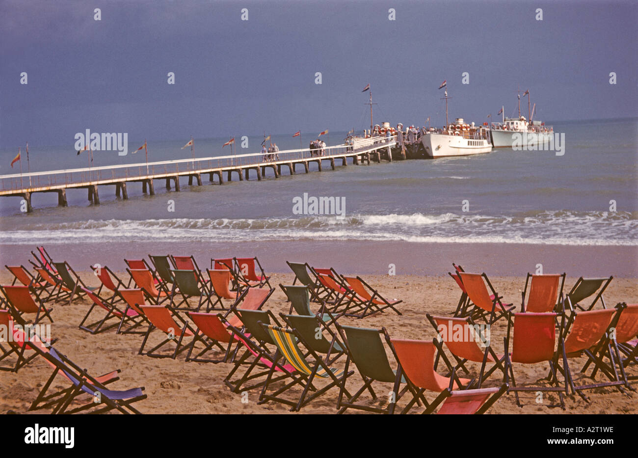 '^Holidaymakers disembarking from a 'boat trip', empty deckchairs, ^1960, Bournemouth' - Stock Image