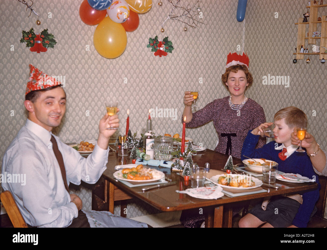 Parents And Six Year Old Son Celebrating Christmas Dinner 1958 England