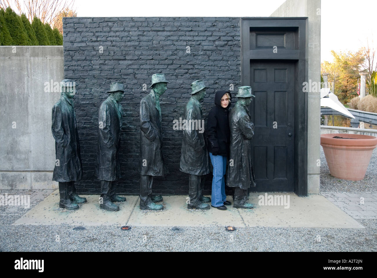 Visitor interacts with George Segal s Depression Bread Line at Grounds For Sculpture Hamilton New Jersey USA - Stock Image
