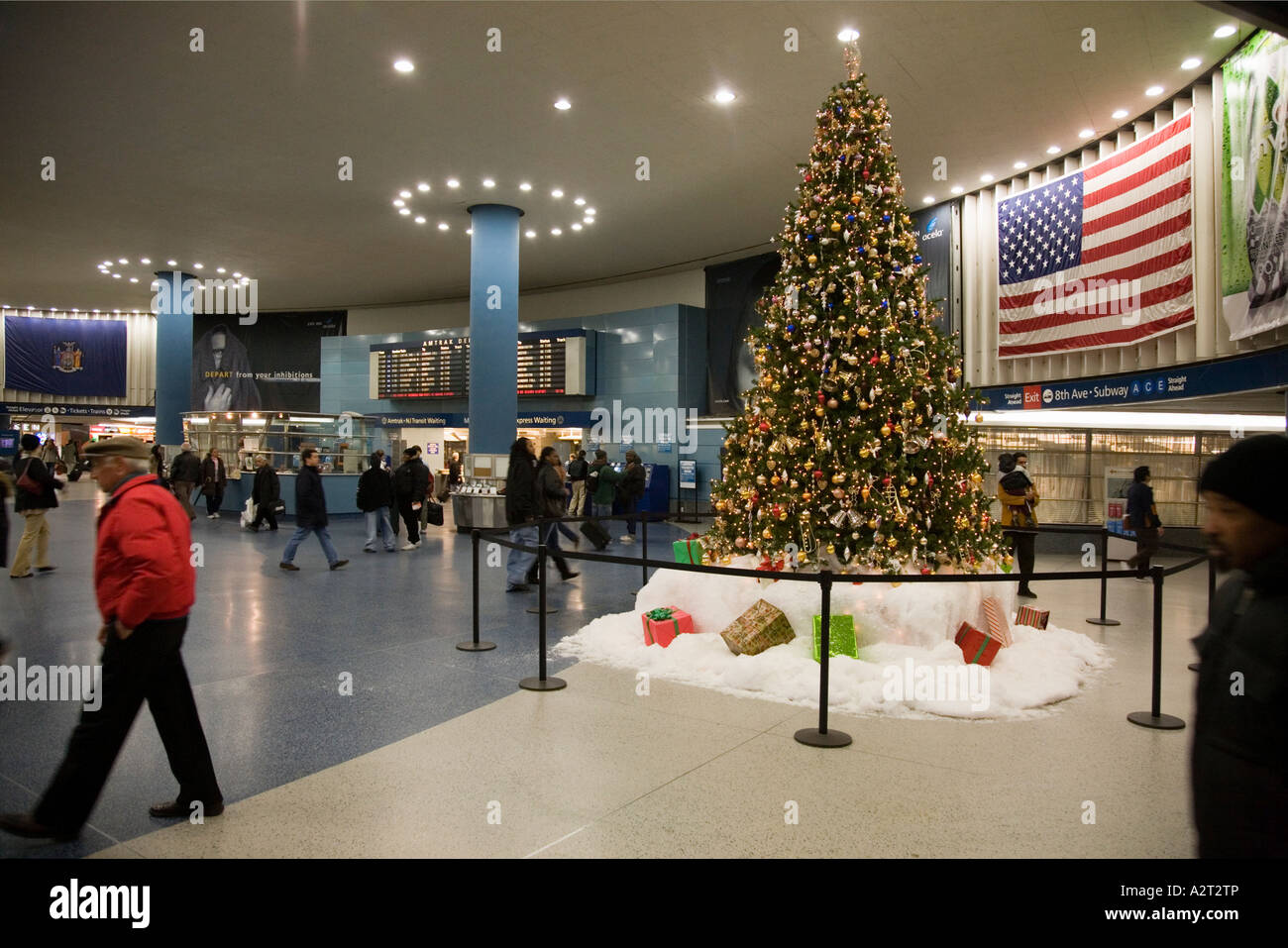 penn station concourse ticket hall with christmas decorations new york city usa