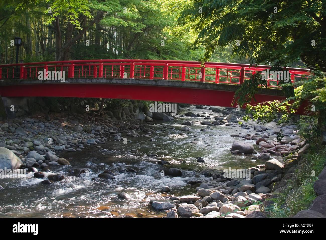 Red arched bridge over the Katsuragawa River Shuzenji Shizuoka prefecture Izu Peninsula JapanStock Photo